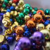 Trade Beads For King Cake This Weekend
